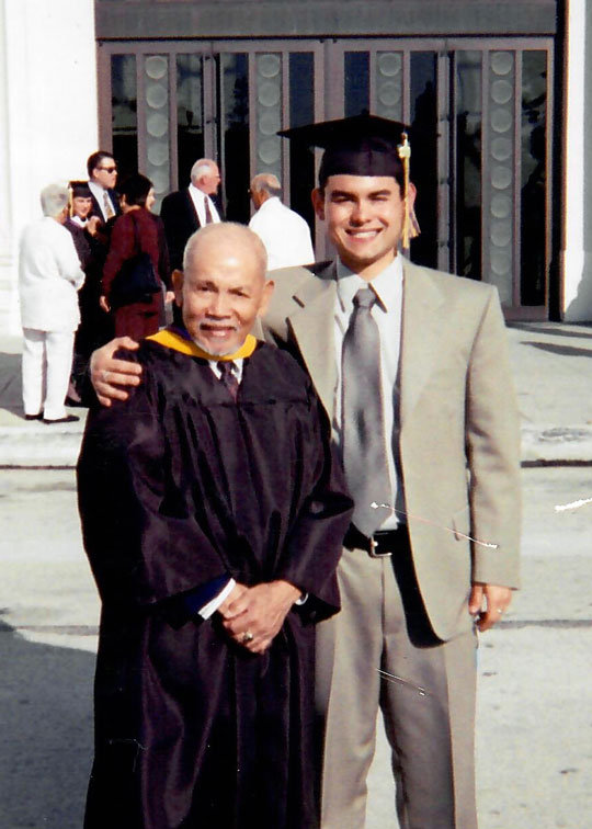 two men standing at graduation